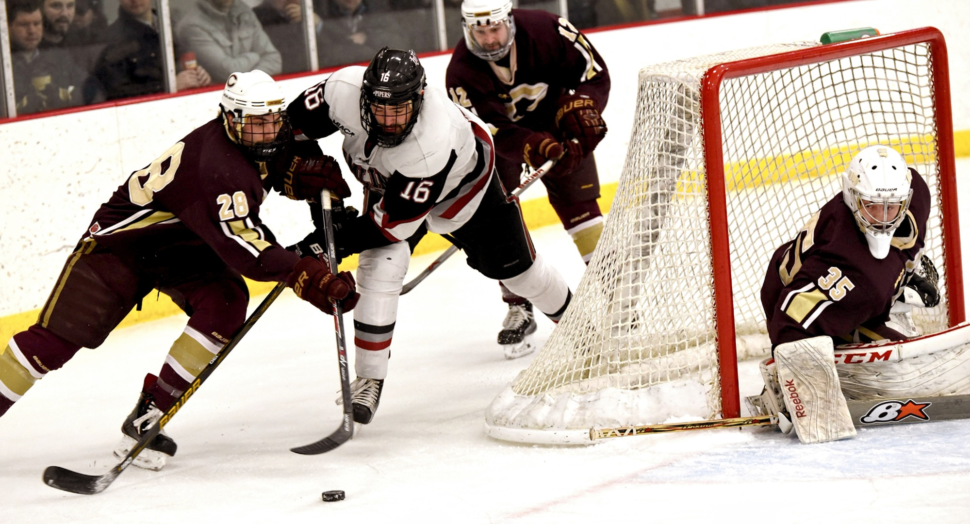 Sophomore defenseman Turk Skatliff tries to control the puck by the Cobber net in Concordia's 3-2 MIAC quarterfinal win at Hamline. (Photo courtesy of Hamline sports information office)