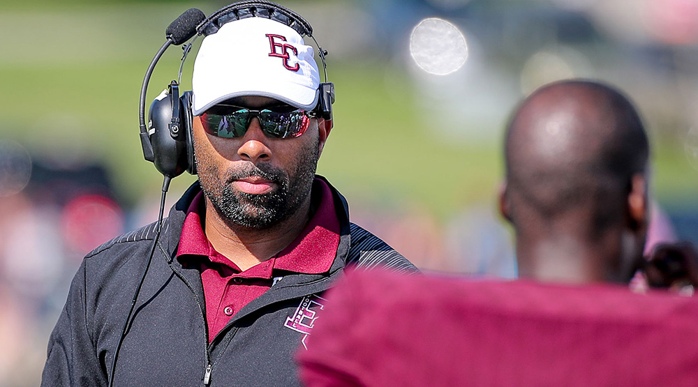 Nick Johnson, on the sidelines midseason in a cap, sunglasses and headset. (Earlham athletics photo)