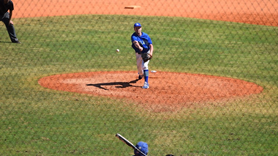 Jon Lynch delivers a pitch in the seventh inning of Salve Regina's season-opener at Winter Haven, Fla. (Photo by Ed Habershaw)
