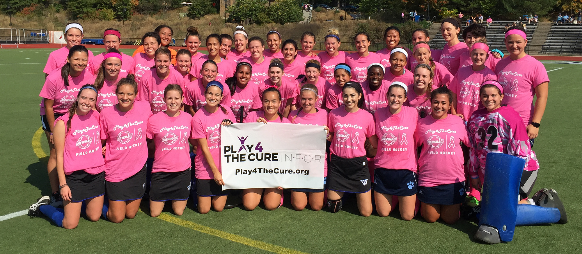 Group photo of the  Mount Holyoke and Wellesley Field Hockey teams prior to October 7th's NEWMAC Play 4 the Cure Game.