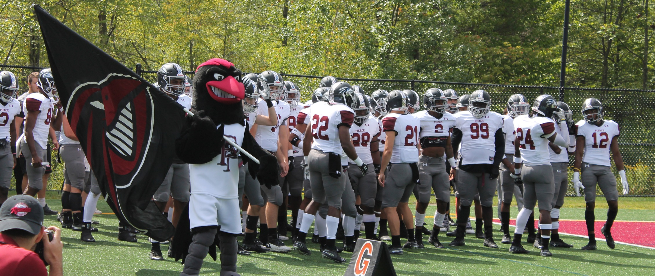 FPU Football and Rocky get ready to run on the field (Photo Courtesy of Maggie McComish)