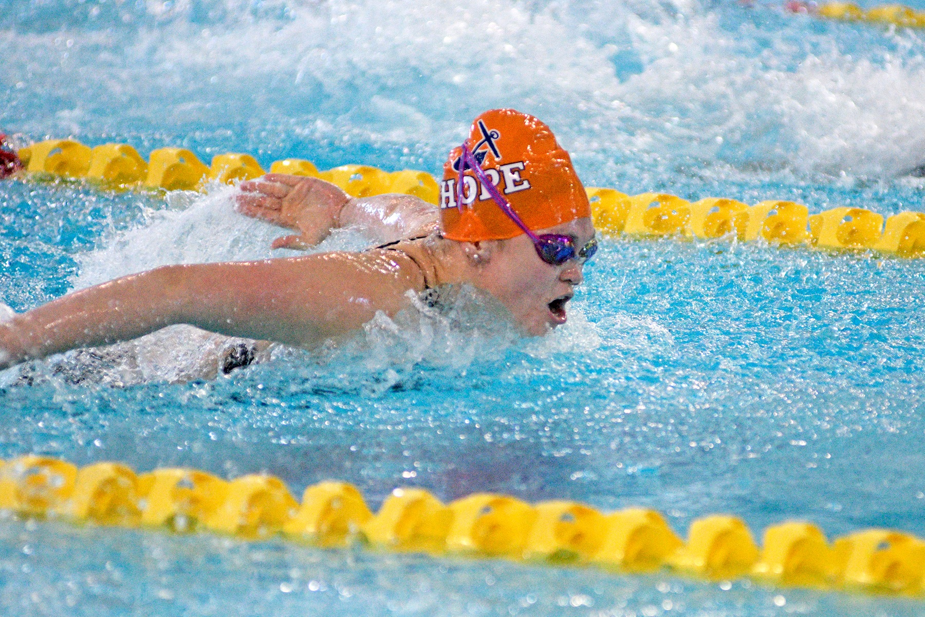 Betsy Craig swims the butterfly.