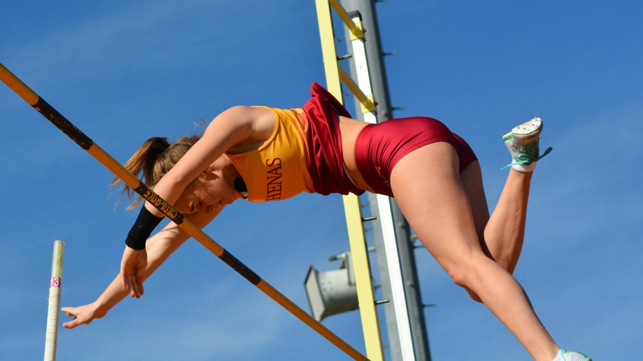 Brooke Simon clearing the bar for a successful pole vault