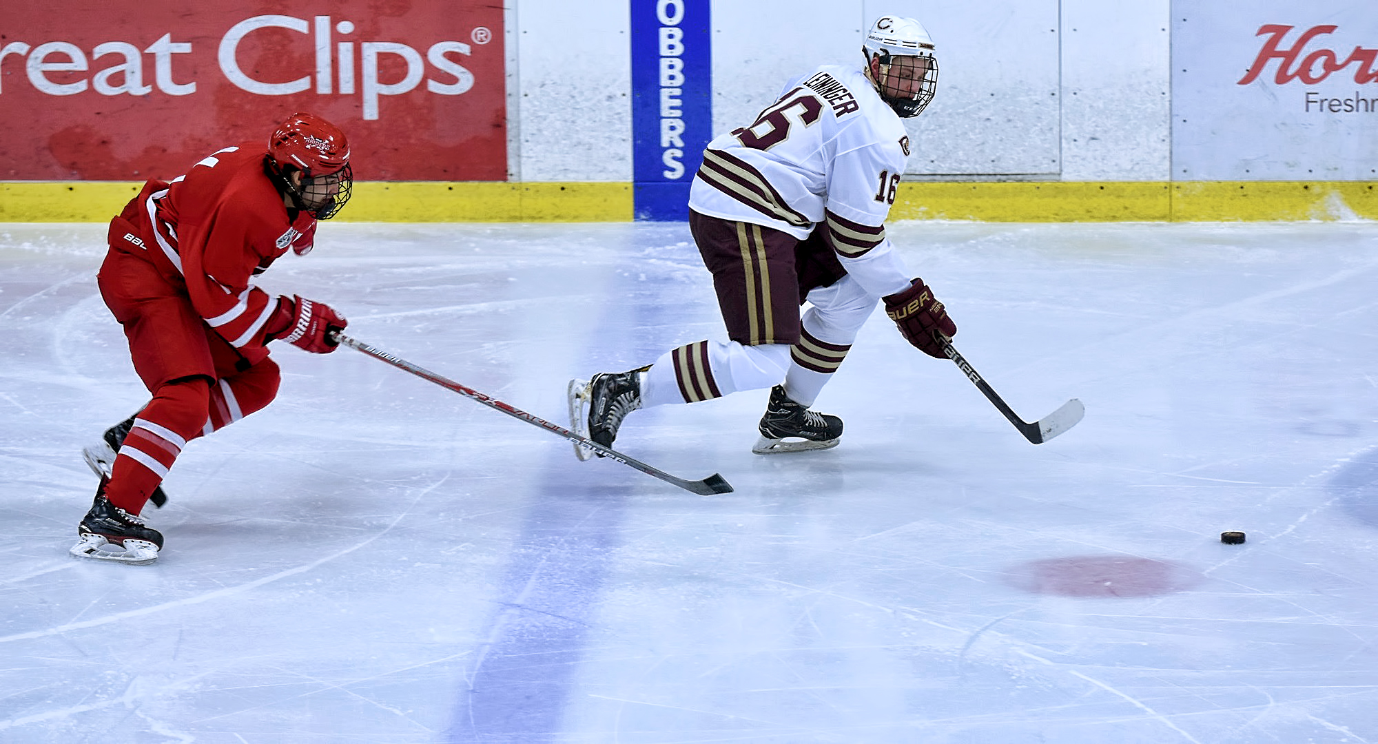 Sophomore Keaton Leininger races the puck up the ice during the Cobbers' 5-3 win over Milw. School of Engineering. Leininger scored his first goal for CC in the second period.