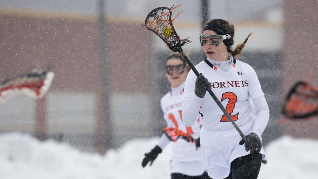 Marianna Olson playing lacrosse.