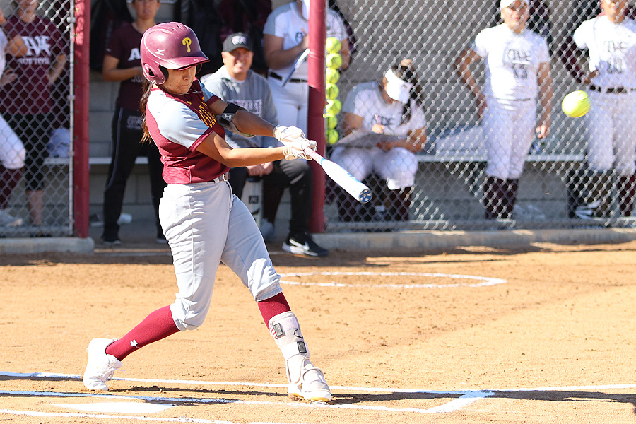 Lancers leadoff hitter Samantha Diaz puts a charge into a ball in a recent game, photo by Richard Quinton.
