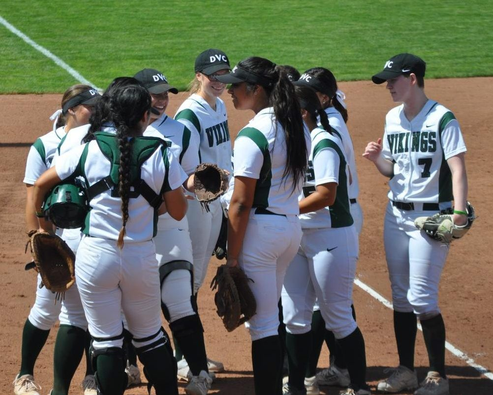 DVC softball gathers together before a game against Sacramento City in Pleasant Hill on March 31, 2018. | Photo by Aaron Tolentino